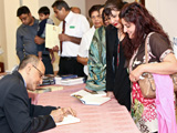 Dr Amyn B. Sajoo signing books at the Leicester book launch IIS 2011.