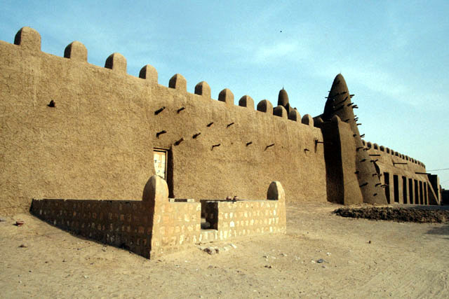"Djingarey Ber, ""the Great Mosque"", is Timbuktu's oldest monument and its major landmark. Located at the western corner of the old town, the mosque is almost entirely built in banco (raw earth). The mosque's maintenance, consisting mainly of repairing the mud rendering, is regularly undertaken upon appeal by the local imam to the population, whose contributions take the form of money, materials and labour."