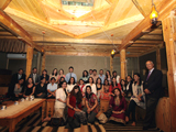 Alumni and staff inside a Pamiri home IIS 2011.