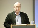 Professor Andrey Smirnov addressing the audience; IIS 2013