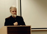 Dr Christopher Melchert of Oxford at lectern IIS 2011.