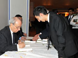 Dr Farhad Daftary Editor signing A Modern History for an IIS volunteer IIS 2011.