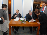Professors Hamdani and de Blois signing copies of the catalogue for members of the audience IIS 2011.