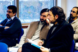 Toby Mayer and Reza Shah Kazemi participating in lecture
