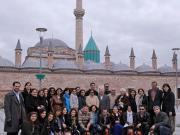Alumni in front of Mevlana Jalal al-Din Rumi's Mausoleum Complex