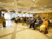 Dr Omar Ali-de-Unzaga speaks to an audience in Lisbon