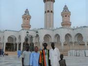 The author, Rizwan Mawani, with Mouride Talibes outside their holy pilgrimage site, the Great Mosque of Touba in Senegal.