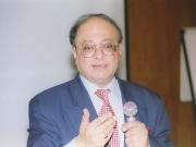 The Late Dr Karim Janmohamed giving at presentation at The IIS